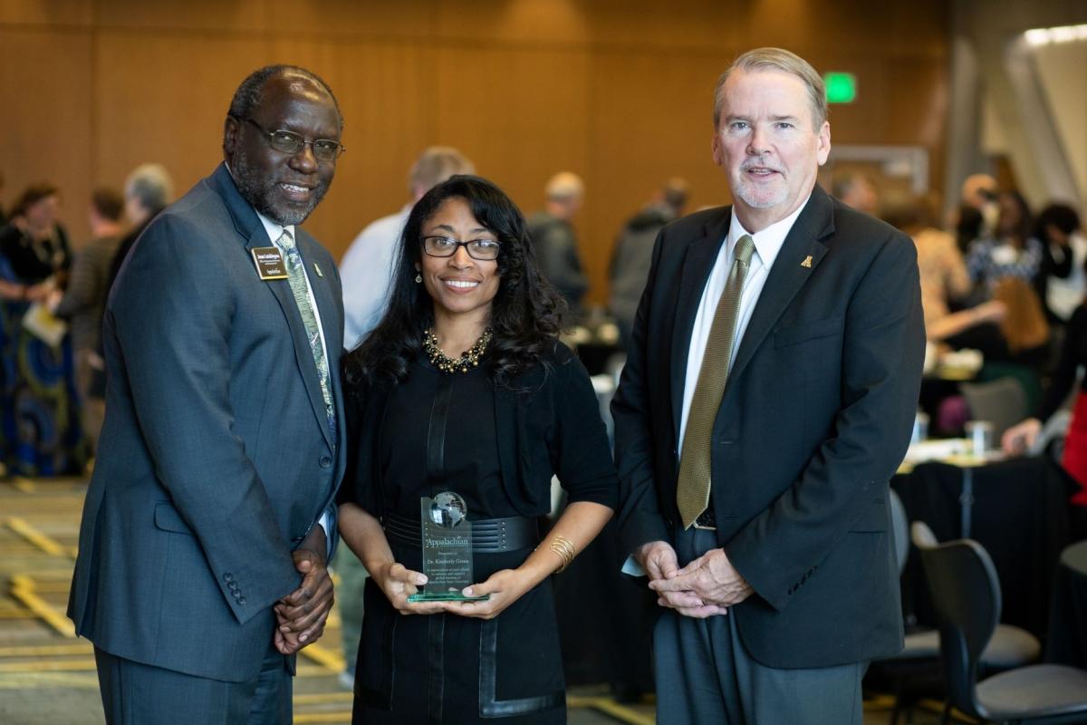 Dr. Kimberly Green receiving 2019 Global Engagement Award