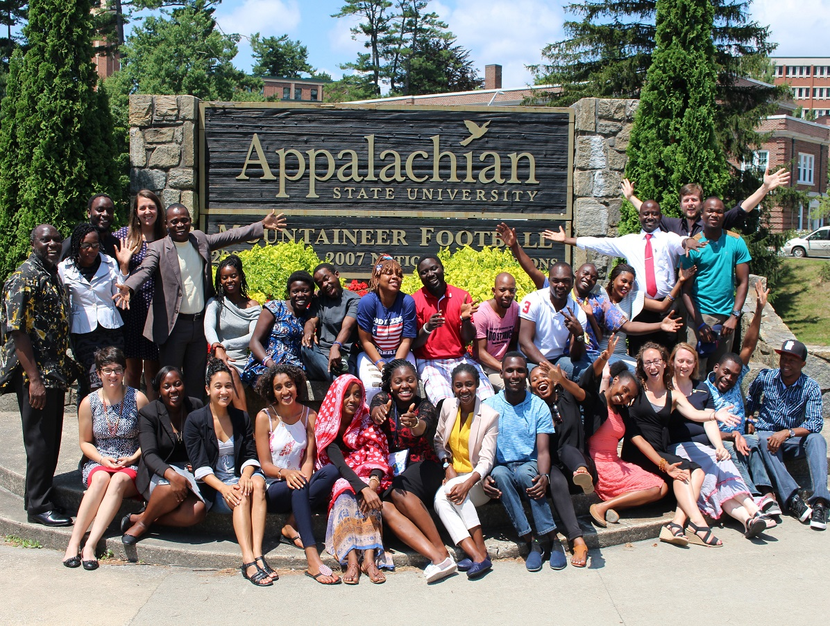 Fellows in front of the Appalachian Welcome Sign