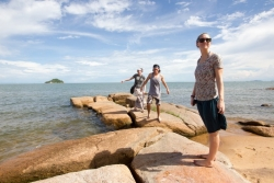 Ellen Mason, Zion Greenfield and Nyssa Turnbow explore the shoreline of Lake Malawi.