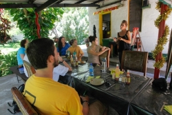 Samantha Ludick, owner of Cool Runnings Guest House in Senga Bay, speaks to Appalachian students about social entrepreneurship. Ludick gives 45 percent of her business's profits to the local community through projects she runs. The projects are related to