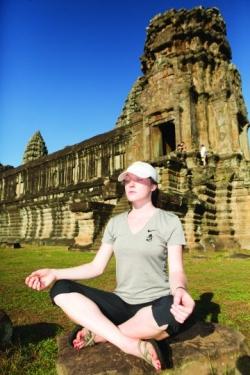ASU International Student in Vietnam in yoga pose.