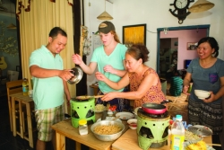 College of Business students get a home cooking lesson in Hoi An, Vietnam.