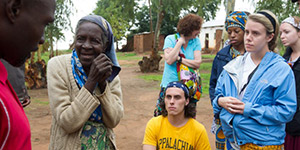 Blessing Chikakula (far left) interprets for Appalachian students as they visit with William Kamkwamba's grandmother in Wimbe Village.