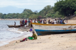 A woman washes clothes on the shoreline of Lake Malawi.