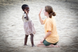 Amanda Kato plays with a young girl from the Senga Bay fishing village.