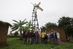 """Students tour Wimbe Village to see how William Kamkwamba, author of """"The Boy Who Harnessed the Wind,"""" transformed his family's life by bringing wind and solar energy into their compound. He continues to experiment with bringing newer technologies to Afric"""