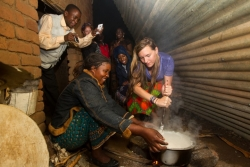 Ellen Mason cooks nsima with the help of her host during the home stay part of the trip.
