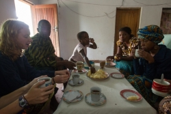Anja Wicker and Alex White share a breakfast of taro root, nsima and tea at their home stay visit.